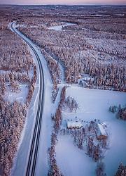 THEMENBILD - Blick über die finnische Winterlandschaft mit der E 63 Strasse und einem Haus umringt vom Wald, aufgenommen am 03. Dezember 2019 in Nissinvaara, Finnland // View over the Finnish winter landscape with the E 63 road and a house surrounded by the forest, Nissinvaara, Finland on 2020/12/03. EXPA Pictures © 2020, PhotoCredit: EXPA/ JFK