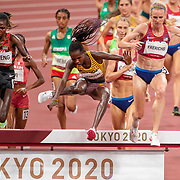 TOKYO, JAPAN August 4: Gold medal winner Peruth Chemutai of Uganda takes an early lead during the 3000m Steeplechase for women closely followed by bronze medal winner Hyvin Kiyeng of Kenya and silver medal winner Courtney Frerichs of the United States as they navigate the water jump during the Track and Field competition at the Olympic Stadium at the Tokyo 2020 Summer Olympic Games on August 4th, 2021 in Tokyo, Japan. (Photo by Tim Clayton/Corbis via Getty Images)