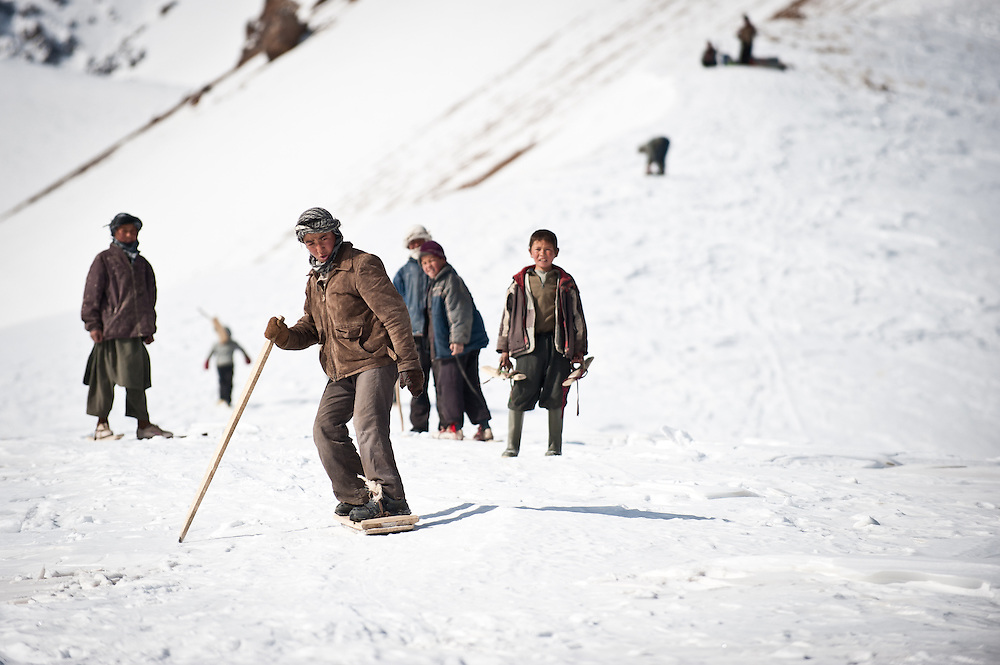 Rajab, 15, a villager from Jawzari, made his snowboard by nailing metal from cooking oil cans to a plank from a tree that he cut down himself.