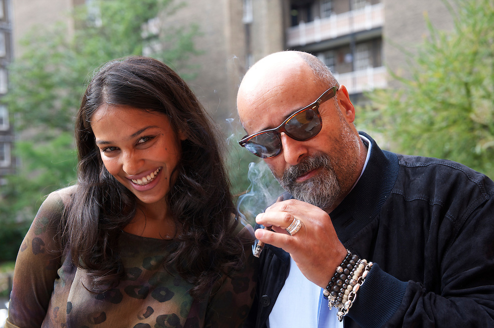 Photographer Richard Young and designer Saloni Lodha share a laugh before her autumn/spring 2010/2011 show held in the map room of the Royal Geographical Society, South Kensington, London on 20 September 2010.