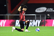 Dominic Solanke (9) of AFC Bournemouth kneels for Black Live Matter before kickoff during the EFL Sky Bet Championship match between Bournemouth and Nottingham Forest at the Vitality Stadium, Bournemouth, England on 24 November 2020.