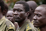 SPLA-IO (SPLA-In Opposition) rebels stand in a line during a parade in Yondu, the day before an assault on government SPLA (Sudan People's Liberation Army) soldiers in the town of Kaya, South Sudan.
