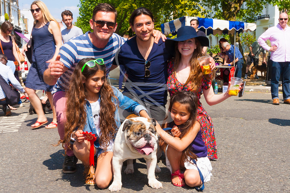 Primrose Hill, London, May 18th 2014. Jack Maslen who plays Jack Branning in Eastenders, left poses with prizewinning Bulldog Nelson, 4 and Danielle, Gital and Tanya at the Primrose Hill Fair and dog show.