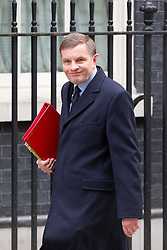 © Licensed to London News Pictures. 18/03/2014. London, UK. The Welsh Secretary, David Jones, arrives for a meeting of the British cabinet on Downing Street in London today (18/03/2014). Photo credit: Matt Cetti-Roberts/LNP