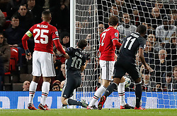 CSKA Moscow's Alan Dzagoev (centre) scores his side's first goal as the ball ricochets off his back during the UEFA Champions League match at Old Trafford, Manchester.