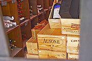 The heavily protected storage room for the most valuable bottles, closed with an iron gate with a strong lock, wooden boxes of wine inside. Peeking through the gate one can see boxes of Chateau Ausone, Saint Emilion, Romanee Conti, Bourgogne Grand Cru, Chateau Cheval Blanc, Chateau Mouton Rothschild and more The Lavinia wine shop in Paris. Probably the biggest wine shop in Paris, with its special temperature controlled section for wines that are fragile and must be stored at cool low temperature.