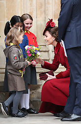 The Duchess of Cambridge receives a posy as she leave after the Commonwealth Service at Westminster Abbey, London on Commonwealth Day. The service is the Duke and Duchess of Sussex's final official engagement before they quit royal life.