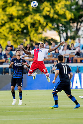June 13, 2018 - San Jose, CA, U.S. - SAN JOSE, CA - JUNE 13: New England Revolution Midfielder Luis Caicedo (27) flies toward a ball during the MLS game between the New England Revolution and the San Jose Earthquakes on June 13, 2018, at Avaya Stadium in San Jose, CA. The game ended in a 2-2 tie. (Photo by Bob Kupbens/Icon Sportswire) (Credit Image: © Bob Kupbens/Icon SMI via ZUMA Press)