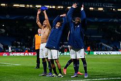 Marquinhos, Lucas and Blaise Matuidi celebrate after Paris Saint-Germain win the math 1-2 to progress to the last 8 of the competition - Mandatory byline: Rogan Thomson/JMP - 09/03/2016 - FOOTBALL - Stamford Bridge Stadium - London, England - Chelsea v Paris Saint-Germain - UEFA Champions League Round of 16: Second Leg.