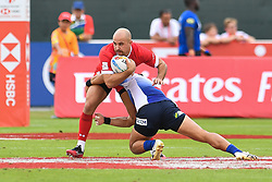 Luke Treharne of Wales is tackled by Yusaku Kuwazuru of Japan <br /> <br /> Photographer Craig Thomas/Replay Images<br /> <br /> World Rugby HSBC World Sevens Series - Day 3 - Saturday 7rd December 2019 - Sevens Stadium - Dubai<br /> <br /> World Copyright © Replay Images . All rights reserved. info@replayimages.co.uk - http://replayimages.co.uk