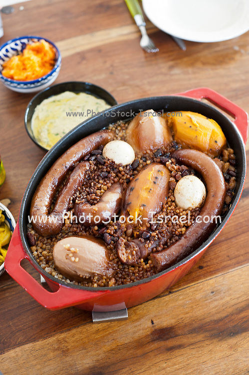 Cholent (also spelt tsholnt or tshoolnt) or hamin is a traditional Jewish stew simmered overnight, for 12 hours or more, and eaten for lunch on the Sabbath
