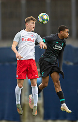 GRÖDIG, AUSTRIA - Tuesday, December 10, 2019: FC Salzburg's Luka Sučić (L) challenges for a header with Liverpool's Elijah Dixon-Bonner during the final UEFA Youth League Group E match between FC Salzburg and Liverpool FC at the Untersberg-Arena. (Pic by David Rawcliffe/Propaganda)