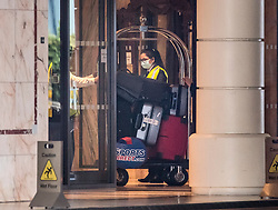 © Licensed to London News Pictures. 16/02/2021. London, UK. Luggage is taken in to the Radisson Hotel near Heathrow airport where travellers arriving in the UK from red list countries will quarantine. New quarantine measures have been introduced for travellers form red list countries, who will be required to isolate for ten days in a hotel at a cost of £1,750 per person. Photo credit: Ben Cawthra/LNP