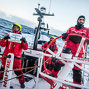 Leg 7 from Auckland to Itajai, day 08 on board MAPFRE, passing Nemo Point., Blair tuke holding the signal, Xabi steering and Tamara at the back 25 March, 2018.