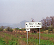 "On the road to the Oremus Winery in Tolcsva in the Tokaj region. Road sign saying 2 km to the ""Boraszat"". A horse drawn cart in the background (as you often see in the region). Oremus is owned by the Alvarez family that also owns Vega Sicilia in Spain It is managed by Andras Bacso. Credit Per Karlsson BKWine.com"