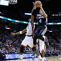 17 January 2012: San Antonio Spurs guard Daniel Green (4) goes for the layup past Miami Heat power forward Chris Bosh (1) during the Miami Heat 120-98 victory over the San Antonio Spurs at the AmericanAirlines Arena, Miami, Florida, USA.