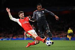 Arsenal's Shkodran Mustafi (left) and FC Bayern's de Souza Douglas Costa battle for the ball
