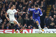 Chelsea striker Diego Costa (19) powering away from Paris Saint Germain attacker Angel Di Maria (11) during the Champions League match between Chelsea and Paris Saint-Germain at Stamford Bridge, London, England on 9 March 2016. Photo by Matthew Redman.