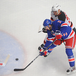May 14, 2012: New York Rangers center Derek Stepan (21) misses a deflection opportunity on New Jersey Devils goalie Martin Brodeur (30) while being defended by defenseman Bryce Salvador (24) during first period action in game 1 of the NHL Eastern Conference Finals between the New Jersey Devils and New York Rangers at Madison Square Garden in New York, N.Y.