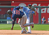Kansas City Royals second baseman Hanser Alberto (49) makes a throw to first after forcing out Minnesota Twins first baseman Miguel Sano (22) at second during the fourth inning at Kauffman Stadium.