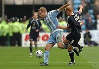 Photo: Leigh Quinnell.<br /> Coventry City v Leeds United. Coca Cola Championship. 18/03/2006. Coventrys James Scowcroft holds off Leeds' Stephen Crainey.