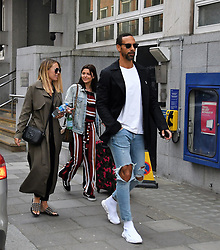 EXCLUSIVE: Rio Ferdinand and Kate Wright were spotted on Savile Row after suit shopping in Ozwald Boateng. Rio was wearing a £500 pair of Balenciaga trainers and ripped jeans, Kate had a khaki mac with a Gucci handbag. 17 Apr 2018 Pictured: Rio Ferdinand & Kate Wright. Photo credit: LDNPIX / MEGA TheMegaAgency.com +1 888 505 6342