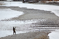 NEWS&GUIDE PHOTO / BRADLY J. BONER.A fly fisherman tries his luck on the Snake River near the Wilson Bridge on Saturday afternoon.  Spring-like weather drew out Jackson Hole residents looking to get a head start on summer activities.