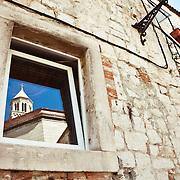 A window reflection of the Diocletian mausoleum and bell tower of the Cathedral of St. Duje (St. Doimus) in Split, Croatia.<br />