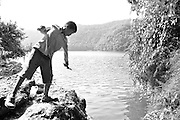 India, the Andaman and Nicobar Islands man fishes with a line and hook