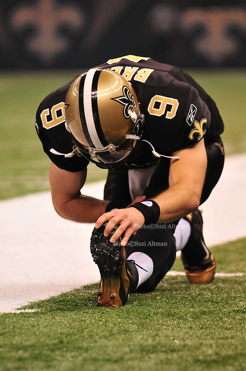 The New Orleans Saints QB Drew Bressstretches just prior to the first series in the game against the seattle Seahwaks. The Saints beat the Seattle Seahawks Sunday Nov. 21, 2010 in New Orleans at the Super Dome. It is RB Reggie Bush's first game to play since breaking his fibula and Reggie is also playing against his old USC college Coach. Photo©SuziAltman.
