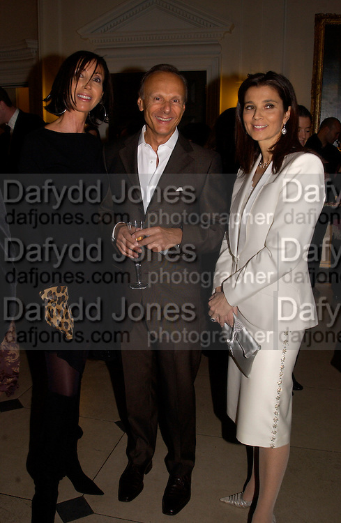 Elaine and Anthony Lassman and  MARRION KHALILI, Private view of 'Heaven on Earth' exhibition. Hermitage. Somerset House. 24 March 2004. ONE TIME USE ONLY - DO NOT ARCHIVE  © Copyright Photograph by Dafydd Jones 66 Stockwell Park Rd. London SW9 0DA Tel 020 7733 0108 www.dafjones.com