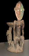 an orators stool with ancestral portrait carved in wood. This stood in the centre of the men's house. The orator would hit the stool with leaves to emphasise his narration or rhetoric. 20th Century, Yatmul Tribe, Papua New Guinea