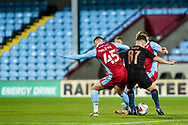 Brothers John McAtee (45) of Scunthorpe United and James McAtee of Man City u21 battles for possession with during the EFL Trophy match between Scunthorpe United and Manchester City at Glanford Park, Scunthorpe, England on 29 September 2020.