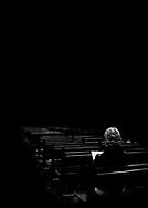 Man in church, reading
