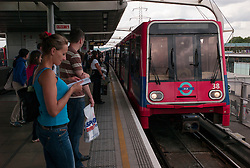 © Licensed to London News Pictures. 23/08/2012, London, UK.  A DLR train arrives at Canning Town station in east London, Thursday, Aug. 23, 2012. DLR, Docklands Light Railway, is celebrates its 25th annivesary today. Photo credit : Sang Tan/LNP
