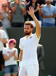 Ernests Gulbis celebrates victory over Juan Martin Del Potro on day four of the Wimbledon Championships at The All England Lawn Tennis and Croquet Club, Wimbledon.