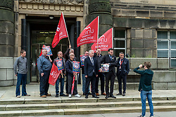 Pictured: Paul Sweeney, Labour and Co-operative MP for Glasgow North East, MSP James Kelly and engineering workers from St Rollox works (Caledonian Works)<br /><br />Paul Sweeney, Labour and Co-operative MP for Glasgow North East, was joined by MSP James Kelly and engineering workers as he handed in a petition at St Andrews House in Edinburgh today highlighting the final scheduled week of work at the St Rollox railway engineering works in Springburn which demands action to prevent the unnecessary loss of 200 skilled jobs in his constituency.<br /><br />Ger Harley | EEm 23 July 2019