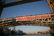 Banners were dropped on bridges crossing the Thames in protest against the inauguration of Donald Trump, January 21st 2017 in London.  A banner on Tower Bridge. On Friday 20th January over 50 groups across the United Kingdom dropped banners from bridges as an act of defiance against Trump's inauguration. The groups, who form the 'Bridges not Walls' movement, staged their demonstration to show support for people in the USA and beyond fearing the consequences of Trump's election. <br /> <br /> In London ten iconic bridges on the Thames saw huge banners 25m long unfurled on them.