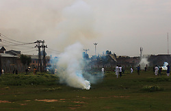 June 26, 2017 - Srinagar, Jammu and Kashmir, India - Kashmiri Muslims protesters chase Indian policemen and paramilitary soldiers during a protest near Eidgah, or an open-air mosque, in Srinagar, Indian controlled Kashmir, June 26 2017 ,Indian forces used tear gas and pellets to disperse hundreds of stone-throwing protesters who took to the streets after Eid al-Fitr prayers protesting (Credit Image: © Umer Asif/Pacific Press via ZUMA Wire)