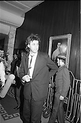 Bob Geldof Receives F.A.O.Medal..1986..16.10.1986..10.16.1986..16th October 1986..The highlight of Gorta's 21st anniversary World Food Day was the presentation of an F.A.O.(Food and Agriculture Organisation of the United Nations) to Bob Geldof. The medal was presented by An Taoiseach,Dr Garret Fitzgerald. The medal was in recognition of Bob's efforts and contribution towards famine relief in the Third World. The ceremony took place in The Berkeley Court Hotel in Dublin...Image shows Bob Geldof arriving at the Berkeley Court for the presentation.