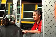Van driver age 18 at Cinco de Mayo festival.  St Paul Minnesota USA
