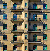 Balconies bathed in afternoon light at an apartment building on North Broad Street in Philadelphia, PA.