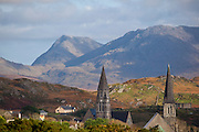 "The town of Clifden, in Connemara, Co. Galway, the ""capital of Connemara"". It's a market town founded in the early 19th century by John D'Arcy. The Twelve Bens, or Pins mountains are in the background, behind the twin church spires."