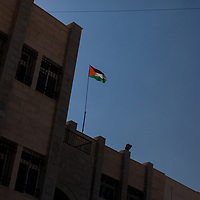 A Palestinian flag flies above a school in the West Bank.