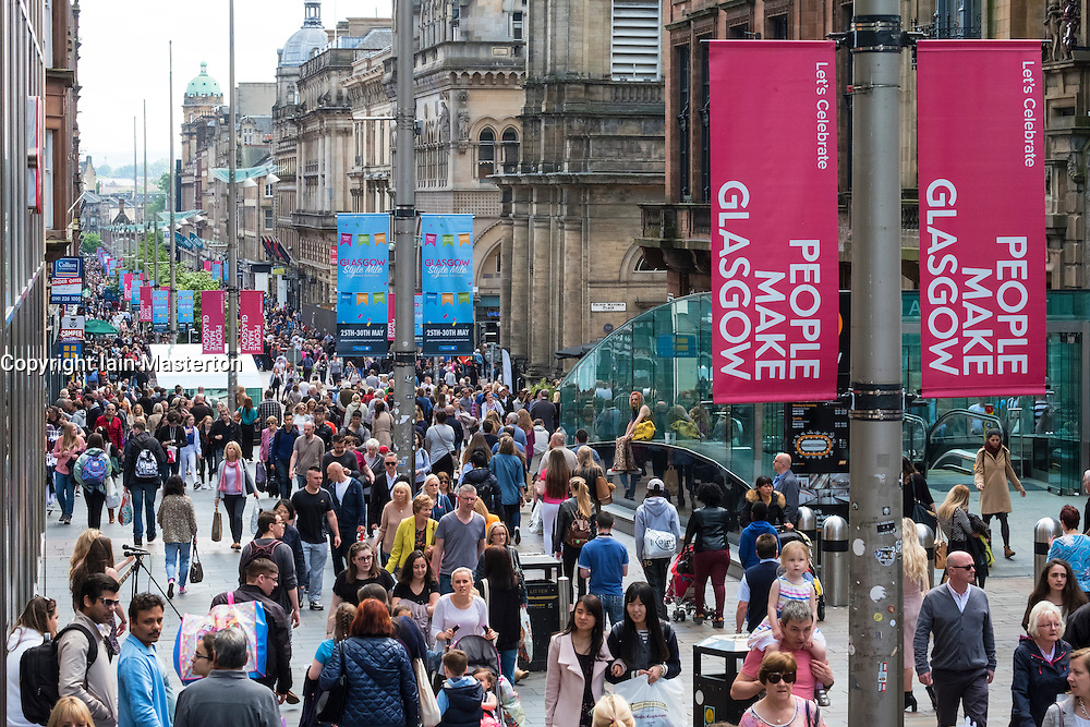 View of shoppers on busy Buchanan Street, popular shopping street,  in central Glasgow United Kingdom