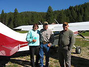Caretaker of Sulphur Creek Ranch preparing to go flying at Sulphur Creek, ID with James Pratt as pilot