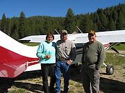 Caretaker of Sulphur Creek Ranch preparing to go flying at Sulphur Creek, ID with James Pratt as pilot