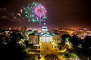 Fireworks explode over the State House in Columbia, SC, at midnight on New Year's Eve.