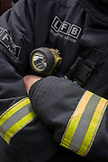 Detail of a firefighter's chest-mounted equipment after a London Fire Brigade's 'extrication' team with the Vehicle and Operator Services Agency (VOSA) who gave a demonstration on how firefighters rescue passengers by cutting open with dedicated cutting equipment a stretch limousine in London's Covent Garden Piazza. Highlighting the dangers of hiring illegal luxury or novelty cars, this vehicle was seized last year with many mechanical defects rendering it unsafe for those inside with limited exit doors. Of 358 cars stopped in March 2012, 27 were seized and 232 given prohibitions. This scenario is a simulation and therefore reproduces the reality of an emergency, using real emergency services personnel and equipment. Casualties are volunteers and none were injured in the making of this photograph.