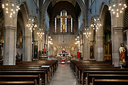 Mcc0094828 . Daily Telegraph <br /> <br /> DT News<br /> <br /> The Church at St Mary's Cadogan Street has been serving it's Parishioners since it's opening by Cardinal Manning in 1879 but due to the Corona Virus pandemic has now had to close it's doors . <br /> In order to continue providing support during this unprecedented time Father Shaun Middleton , who also acts as the Chaplain for The Royal Hospital Chelsea , has begun streaming mass 5 days of the week .<br /> <br /> <br /> London  31 March 2020